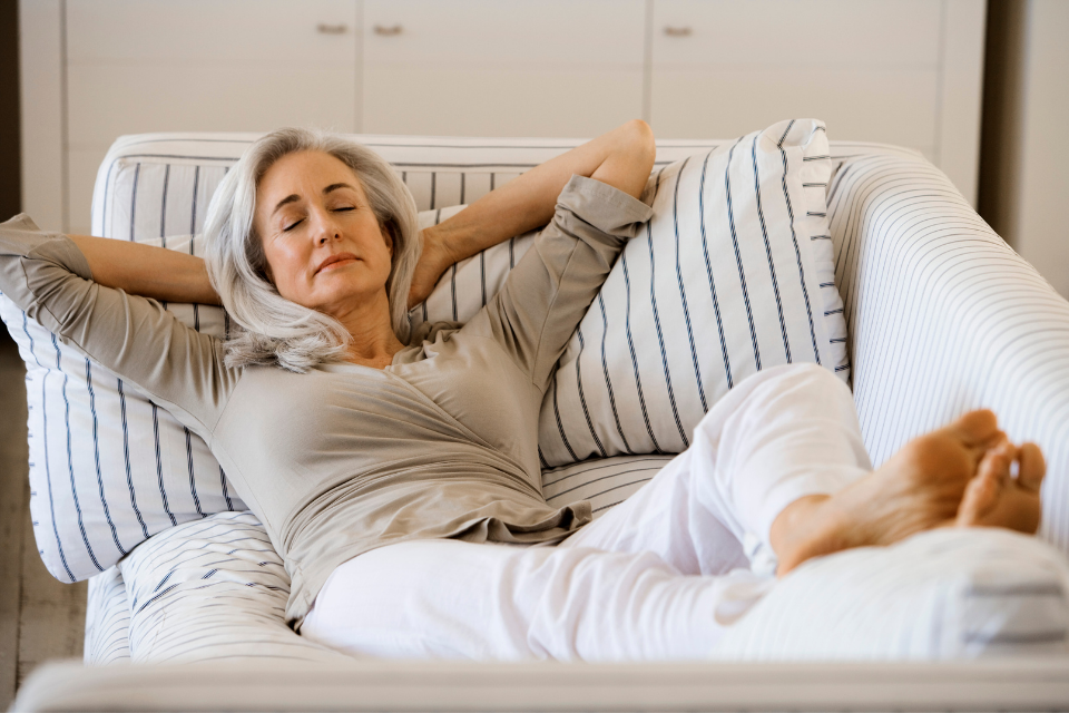 A woman relaxing on her couch