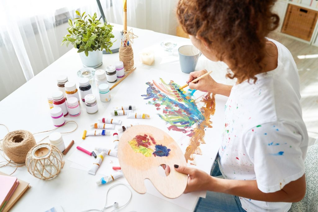 A woman painting to reduce stress